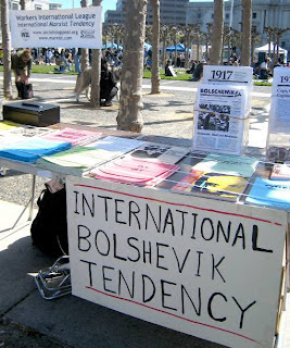 """Photo: a stand with the label, """"International Bolshevik Tendency"""", with leaflets commemorating the 1917 Russian Revolution"""
