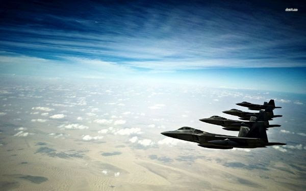 A squad of F-22 Raptors soar in the wild blue yonder.