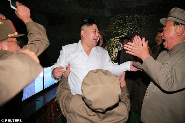 North Korean dictator Kim Jong-un was seen celebrating after the launch last night