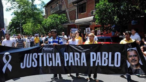 Marcha en Asunción en reclamo por la muerte de periodistas. (AFP)