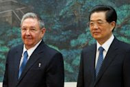 Cuban President Raul Castro (left) and China's President Hu Jintao stand together during a signing ceremony at the Great Hall of the People in Beijing. China has pledged financial aid to Cuba as it undertakes historic economic reforms, promising Castro a new credit line as well as help in health care and technology