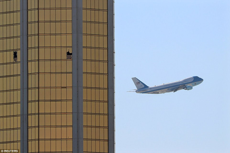 Air Force One passes the broken windows of the Mandalay Bay hotel, where shooter Stephen Paddock conducted his mass shooting along the Las Vegas Strip in Nevada on October 4. He reportedly fired more than 1,100 rounds during the shooting, which was the worst in modern US history