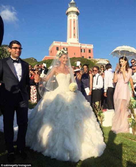 Jessica Hart flaunts curves at Italian wedding with fiancé