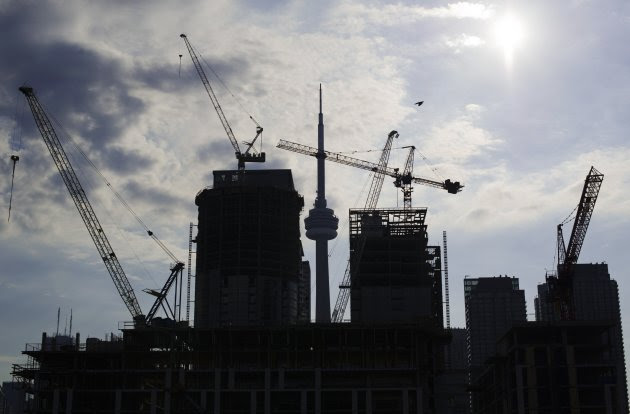 Condominiums are seen under construction in Toronto, in this July 10, 2011 file photo. The value of building permits issued in Canada jumped 15 percent to a record C$7.49 billion in October from September on higher construction intentions for non-residential buildings, Statistics Canada said December 6, 2012.  REUTERS/Mark Blinch/Files (CANADA - Tags: BUSINESS CITYSCAPE CONSTRUCTION)