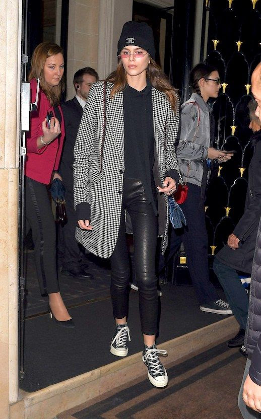 Le Fashion Blog Kaia Gerber Fashion Week Streetstyle Micro Sunglasses Oversized Plaid Blazer Black Sweater Black Cropped Leather Leggings Converse Sneakers Via Vogue