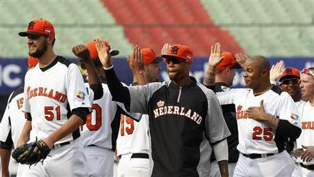 Netherlands' players celebrate after defeating Australia at their World Baseball Classic (WBC) qualifying first round game in Taichung March 5, 2013. REUTERS-Pichi Chuang