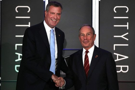 """NEW YORK, NY - OCTOBER 08:  Democratic nominee for New York Mayor Bill de Blasio (L) appears on stage with [then] New York Mayor Michael Bloomberg at """"CityLab: Urban Solutions to Global Challenges,"""" an event sponsored by The Atlantic, The Aspen Institute, and Bloomberg Philanthropies on October 8, 2013 in New York City.></a>    <P><img src="""