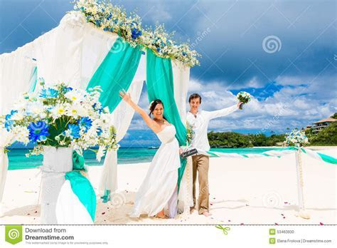 Wedding Ceremony On A Tropical Beach In Blue. Happy Groom