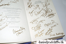 Daniel signs Goblet of Fire book for charity