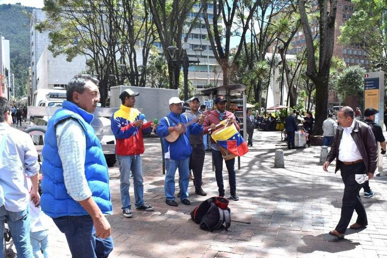 A Venezuelan folk band plays on the streets of Bogotá, Colombia. The number of Venezuelans in Colombia has increased 10-fold amid that nation's economic collapse.