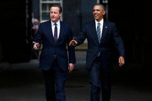 Britain's Prime Minister David Cameron, left, walks with US President Barack Obama, from 10 Downing Street, London after a meeting, Friday, April 22, 2016.