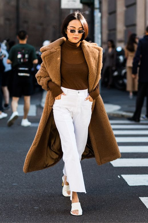 Le Fashion Blog Sunglasses Brown Long Teddy Coat Brown Turtleneck White Pants White Sandals Via Sandra Semburg