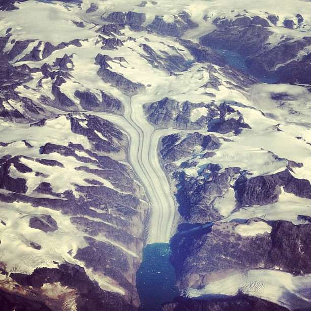 Life is fluid.  We are never stuck because we can always change ourselves. (Taken somewhere over Greenland)