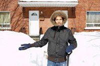 Photo: A person standingby a snow bank.