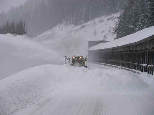 Crews clear avalanche debris at the snowshed
