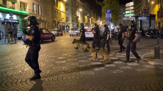 Police on patrol with dogs in France
