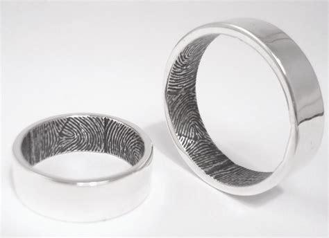 Brent & Jess's unique custom fingerprint wedding rings