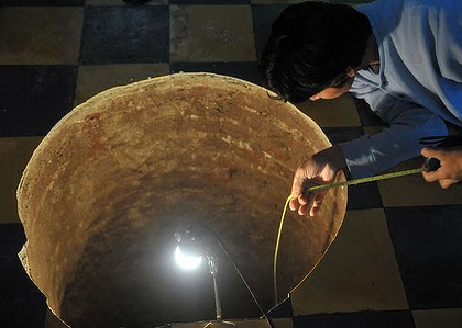 Mind the gap ... a man inspects a sinkhole inside a house in Guatemala City.