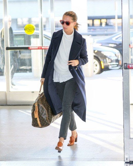 Le Fashion Blog Alicia Vikander Airport Style Sunglasses Long Coat Blouse Jeans Heeled Mules Via Vogue