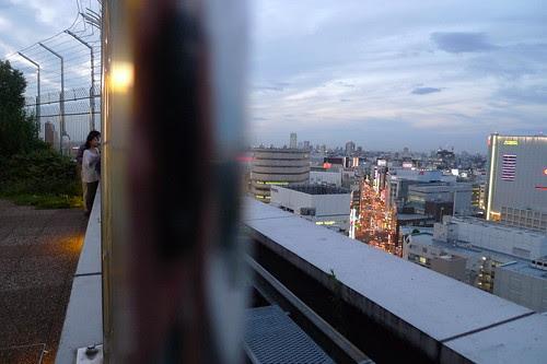 Amorous couple watching the Shinjuku scenery