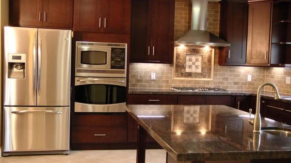Shaker style cabinets, in a espresso finish, granite counter tops ...