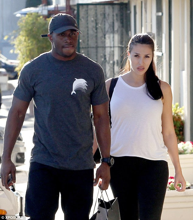 Happy couple: Reggie and his current girlfriend Lilit go for a stroll in Los Angeles in January