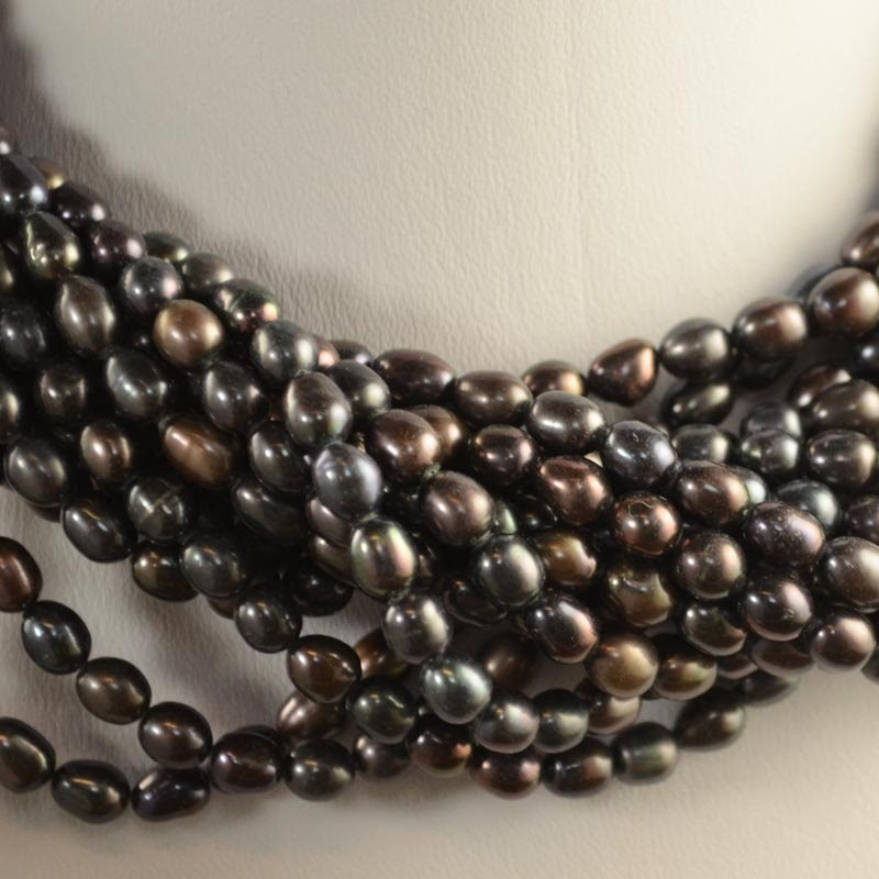 s35589 Freshwater Pearls - 5 x 6 mm Oval Pearl - Bronzed Charcoal (strand)