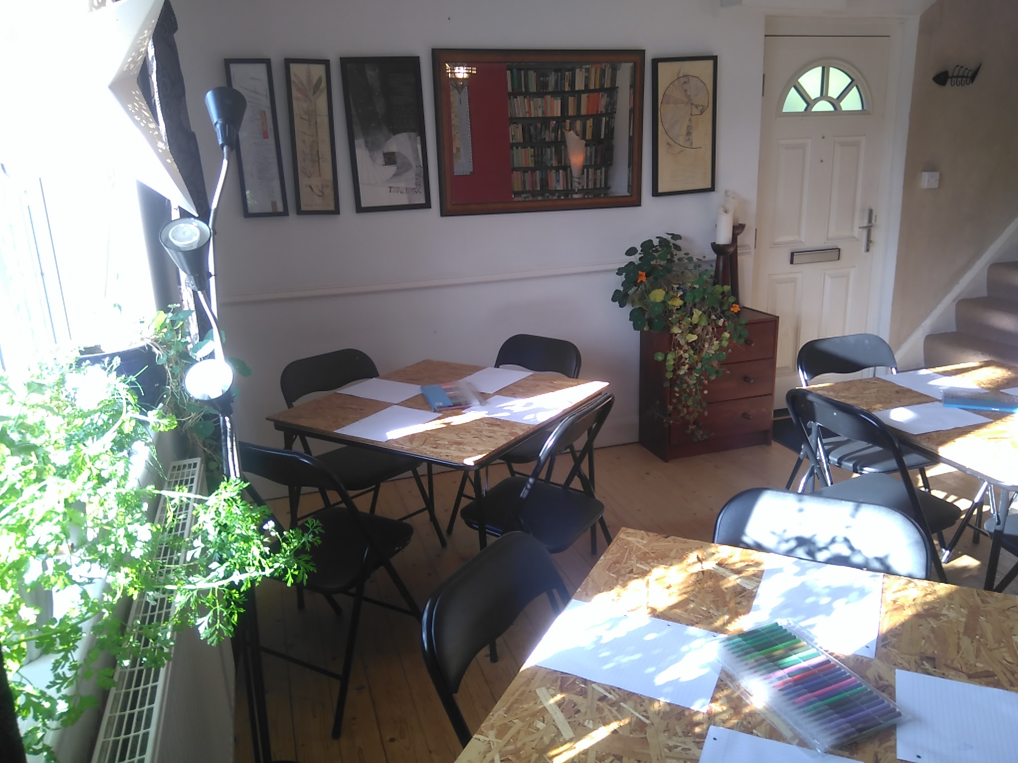 Tables, plants and paintings - the workshop space for summer workshops