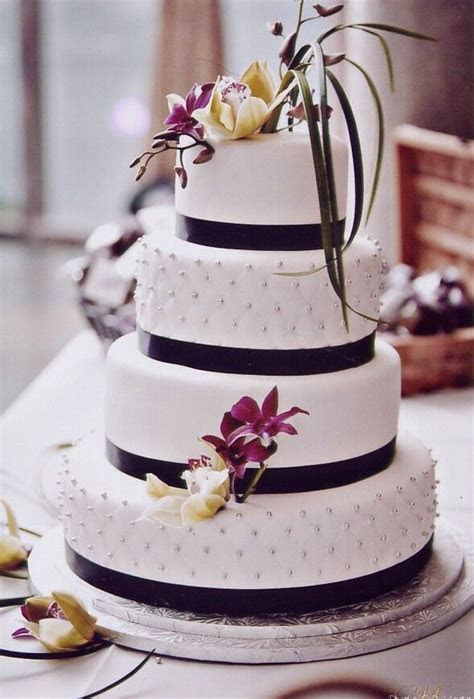 Classical white wedding cake with black ribbon accent by