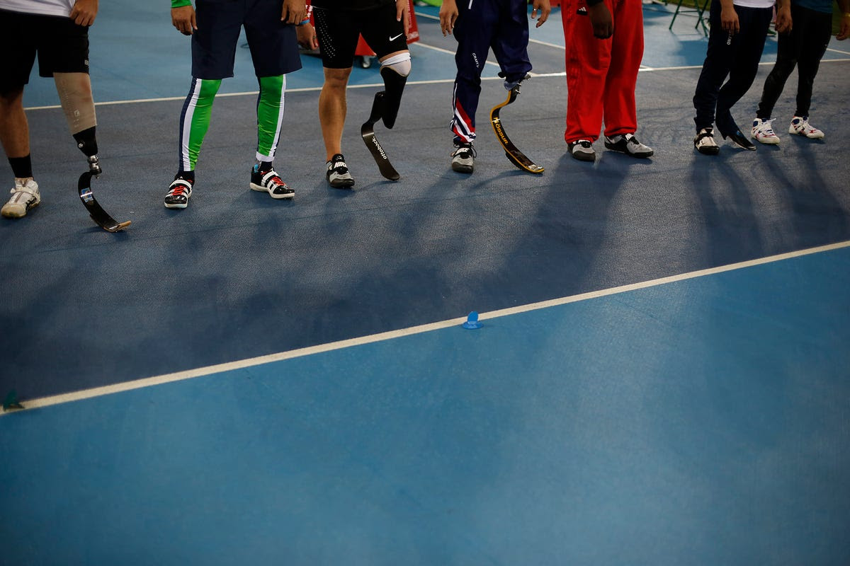 Competitors wait in line before the start of the men's javelin.