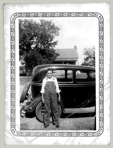 Boy, bib overalls, car