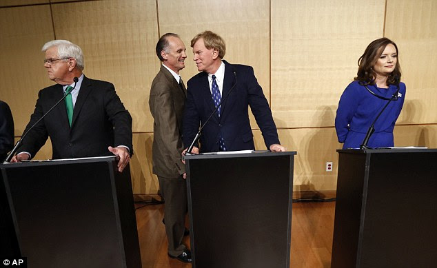 Duke, pictured center, at a debate at Dillard University in New Orleans last week, failed to get himself elected to the US Senate, despite his claims of mobilizing a movement behind Trump
