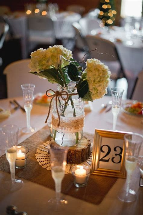 Centerpieces: Homemade! Cut burlap, old dollies, cut wood