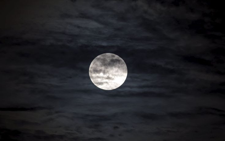 A supermoon, the last of this year's supermoons, is pictured in the sky in Managua