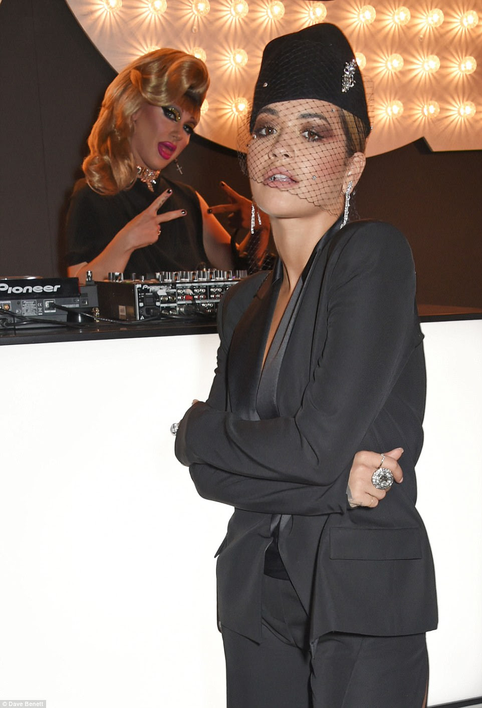 Smouldering: The stunner was posing up a storm while DJ Jodie Harsh photobombed her from the side