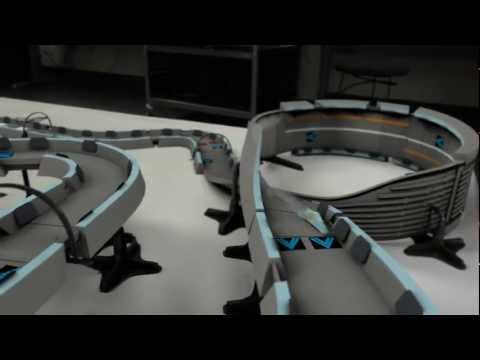 video que muestra un scalextrix con coches por levitación cuántica