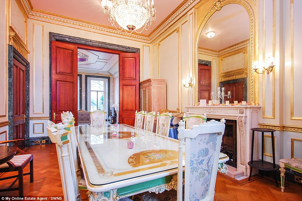 The home's dining room. An estate agent would typically charge around £430,000 in fees for the sale of a home such as this