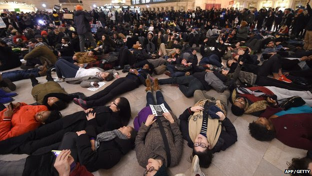 Protesters lay down in New York's Grand Central Station after the announcement that a police officer will not face charges