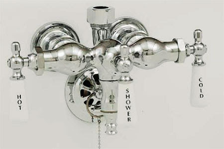 Old fashioned clawfoot leg tub faucets by Sign of the Crab
