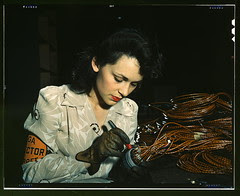 Woman aircraft worker, Vega Aircraft Corporation, Burbank, Calif. Shown checking electrical assemblies (LOC)