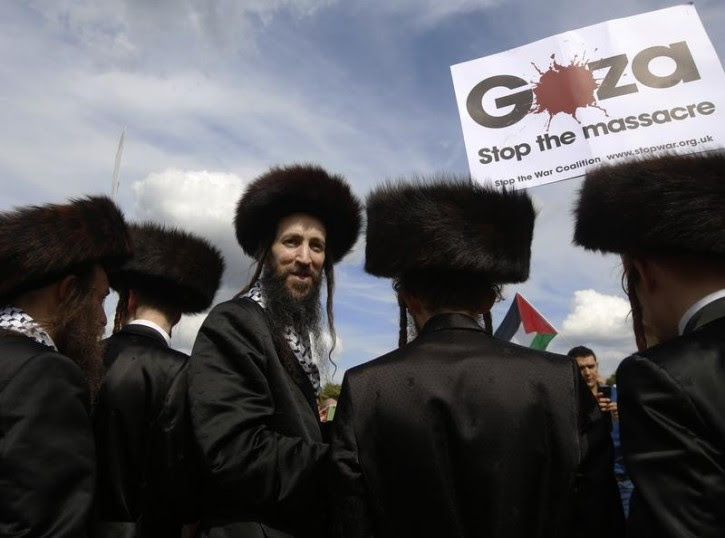 Jewish men join a protest to support the people of Gaza, in central London August 9, 2014. Reuters
