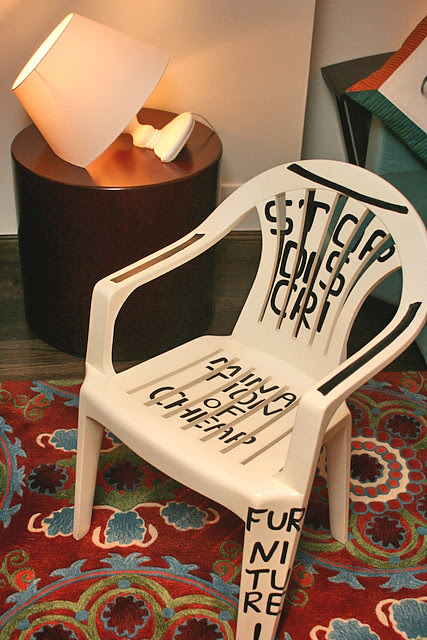 This is not a plastic chair. It's solid wood! Check out the semi-submerged lamp too!