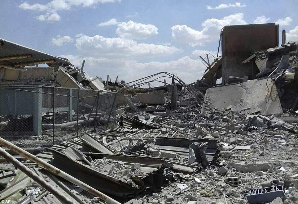 Scores of fast jets, fighters and destroyers fired more than 100 missiles at three military targets in Syria on Friday night in retaliation for President Assad's chemical weapons attack on the rebel enclave of Douma on April 7. Pictured: The remains of the Syrian Scientific Research Center on Saturday