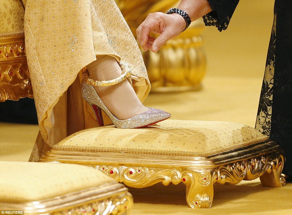 Shoes fit for a princess: The bride wore jewel-encrusted Christian Louboutin heels, as well as a chunky pure gold anklet