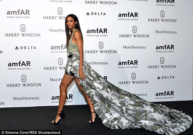 Gorgeous: The star put on a leggy display in her number as it featured a waterfall shape design, which was short at the front and covered a black leather mini skirt