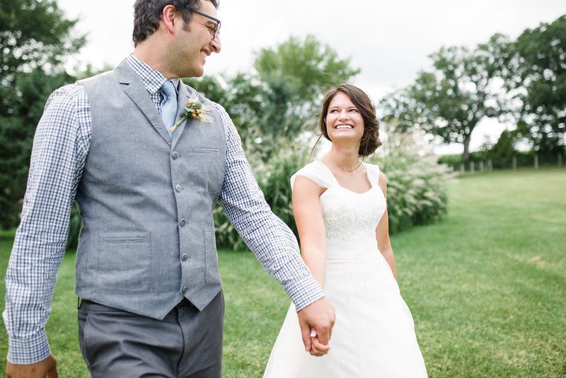 Bride and groom portraits with a candid and rustic vibe a wedding in Fort Atkinson Wisconsin about 30 minutes east of Madison and an hour north of Chicago. Photo by Mindy Joy Photography.