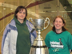 Standing in front of the Grey Cup