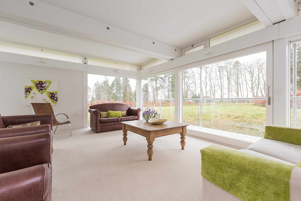 Antonio's house boasts four large reception rooms, as well as five bedrooms. Pictured: One of the lounges at West Linton, a Huf Haus property in Scotland. Huf Haus build only 200 homes worldwide every year and there's currently a waiting list of up to two years