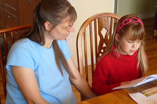 Uwe Romeike supervises one of her daughters during a reading lesson in their Tennessee home