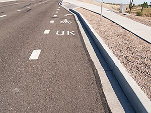 On-street pavement markings tell bicyclists in...